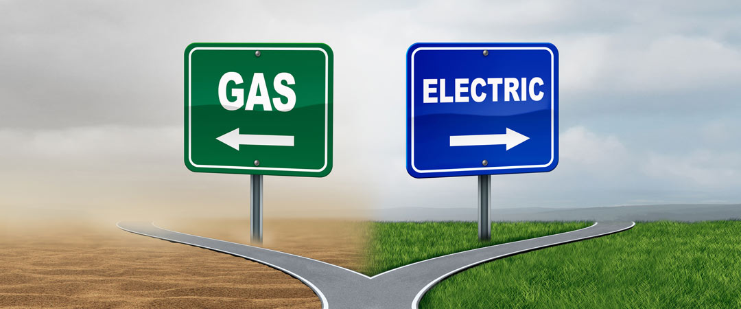 Fork in the road with 2 signs, one gas and one electric