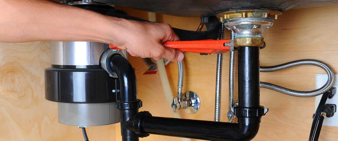 Checking garbage disposal plumbing connections