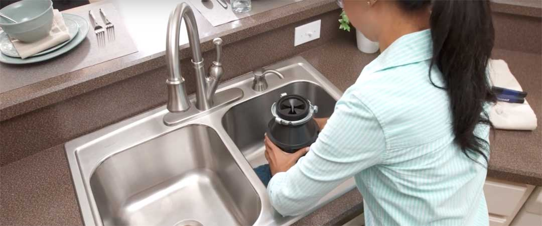 Garbage disposal on towel inside sink