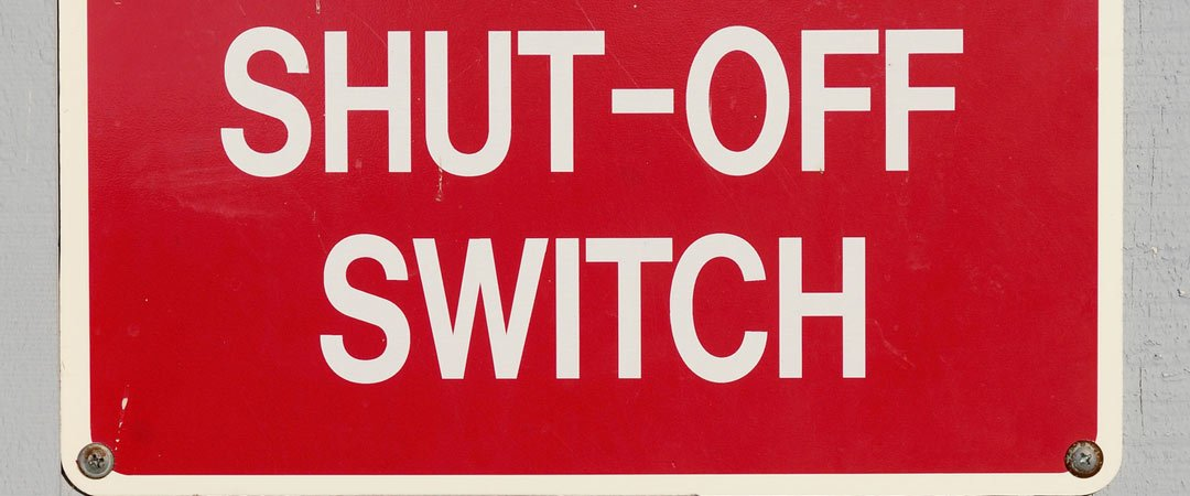 red sign indicating the location of the ac power switch