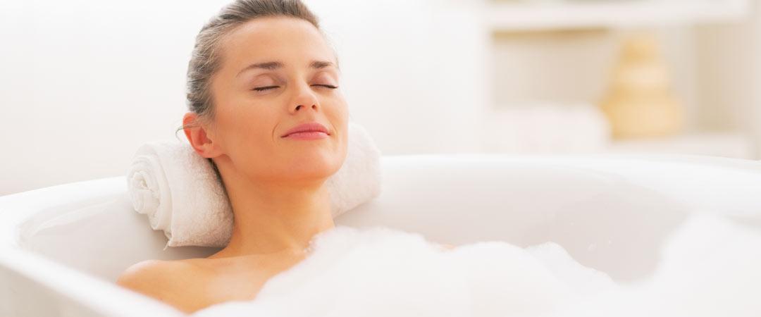 Woman enjoying a hot bubble bath