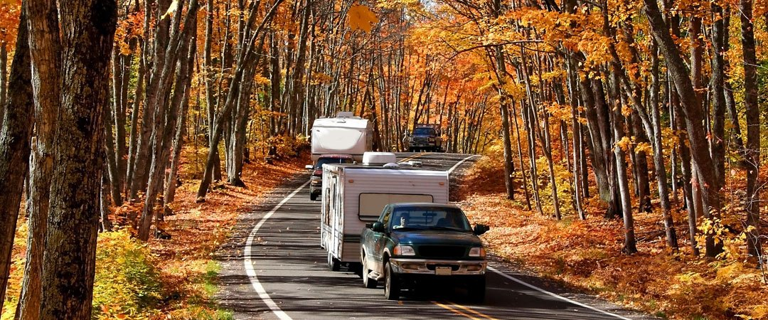 Group of RV's traveling on an Fall morning