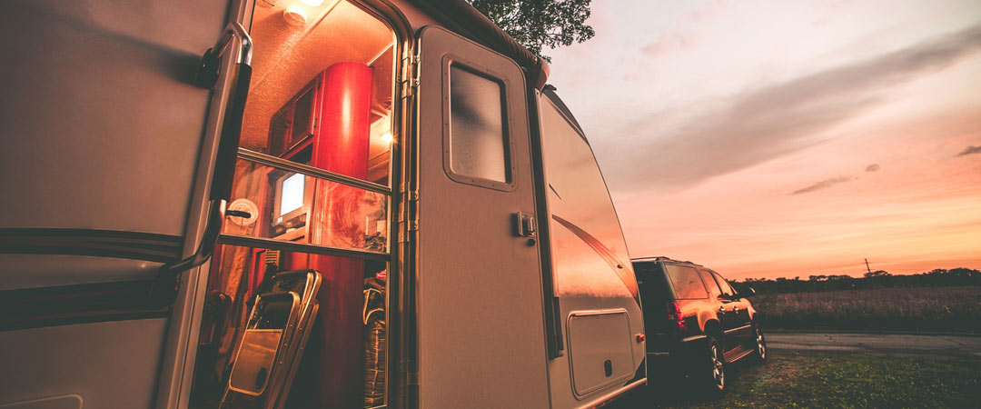 Open door on an RV in the evening