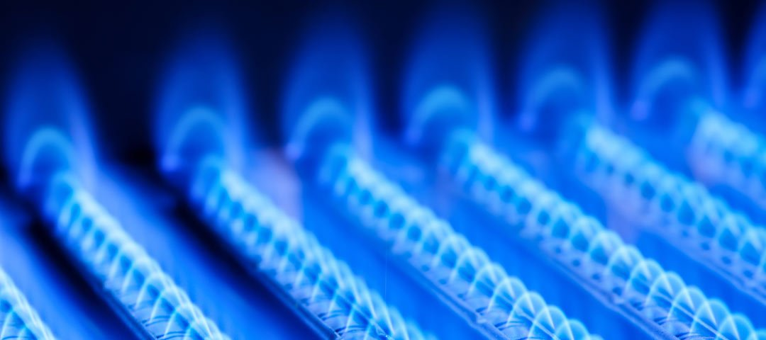 Rows of blue natural gas flames