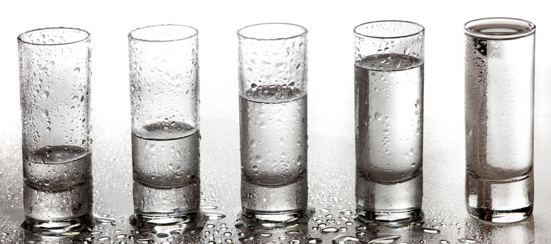 5 glasses with varies amounts of water