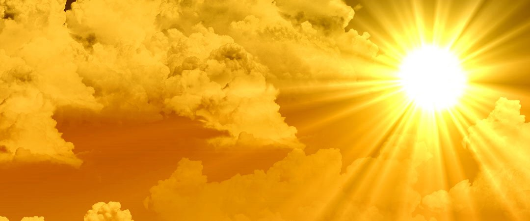 Bright sun breaking through clouds