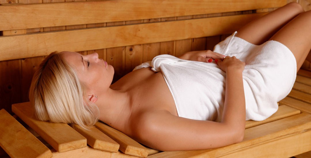Woman enjoying a sauna