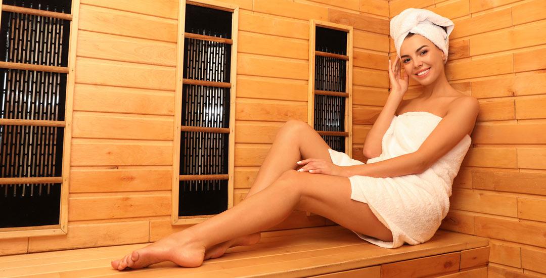 Woman inside an infrared sauna