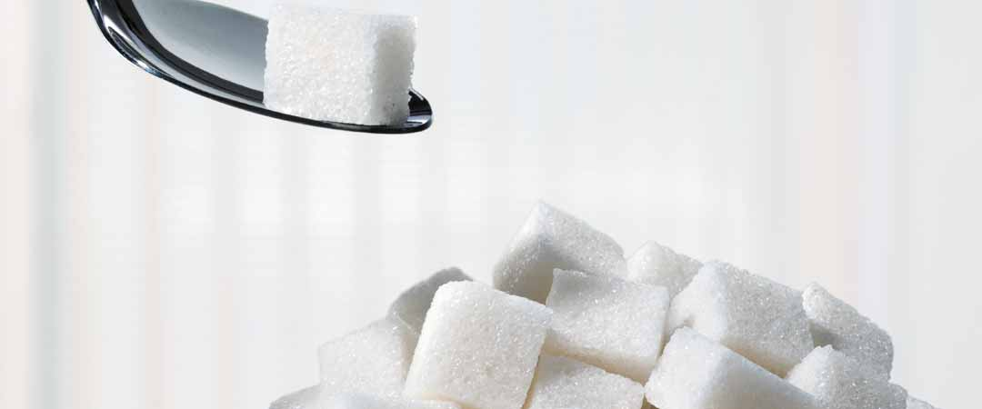 Bowl of sugar cubes with a spoon