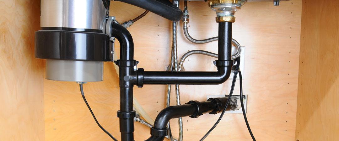Garbage disposal installed under a kitchen sink