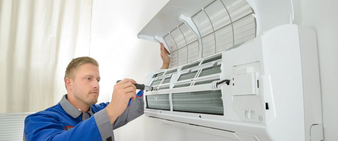 Repairman working on air conditioner