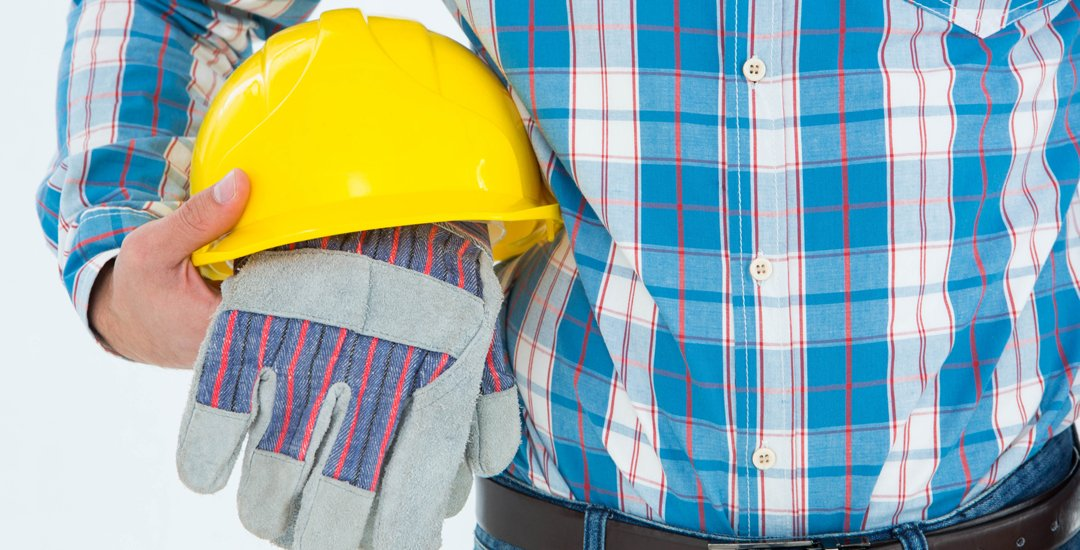 Man with hard hat and work gloves
